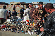 The hardships caused by ten years under an international economic embargo against Saddam Hussein's regime, following the 1991 Gulf War, have spawned flee markets where Iraqis buy and sell clothes and household items to make extra money.<br />