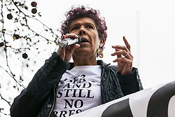 London, UK. 16th March, 2019. Moyra Samuels of the Justice for Grenfell campaign addresses thousands of people on the March Against Racism demonstration on UN Anti-Racism Day against a background of increasing far-right activism around the world and a terror attack yesterday on two mosques in New Zealand by a far-right extremist which left 49 people dead and another 48 injured.