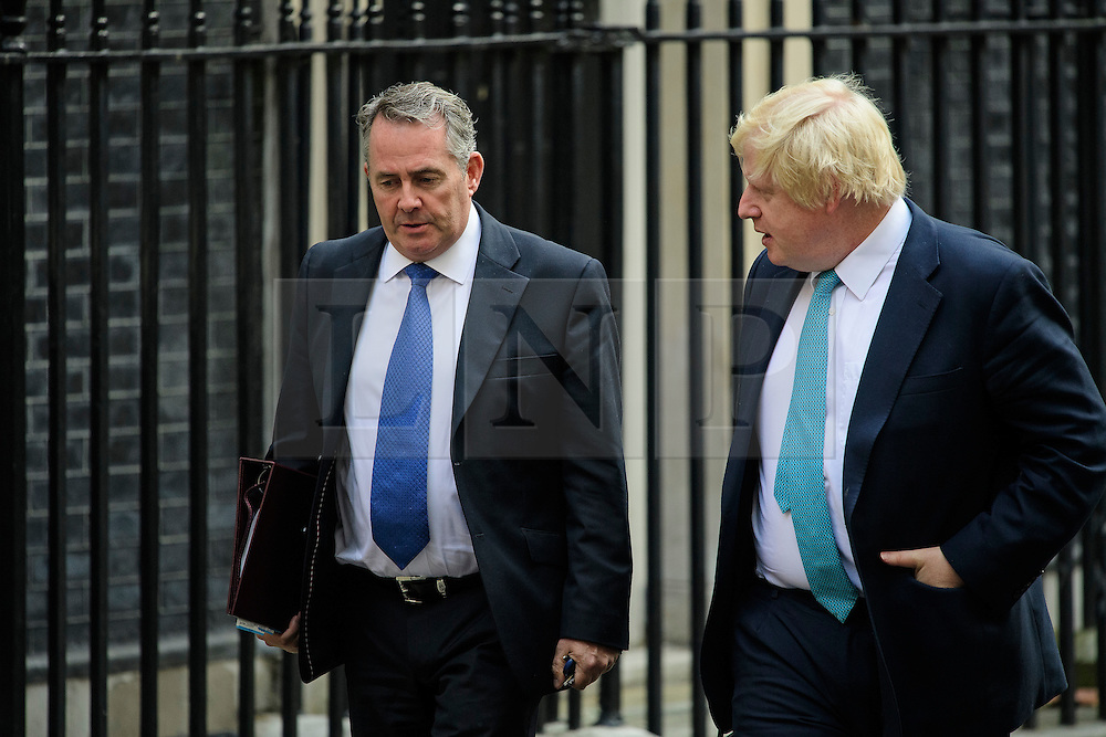© Licensed to London News Pictures. 13/09/2016. London, UK.  Secretary of State for International Trade LIAM FOX (left) and Foreign Secretary Boris Johnson (right) leave 10 Downing Street in London after cabinet meeting on September 13, 2016. Photo credit: Ben Cawthra/LNP