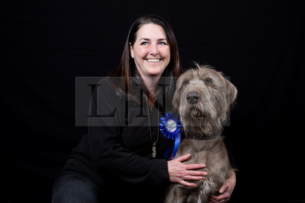 © Licensed to London News Pictures. 11/03/2016. Birmingham, UK. Paula Evans and her Slovakian Rough Haired Pointer named Bear at Crufts 2016 held at the NEC in Birmingham, West Midlands, UK. The world's largest dog show, Crufts is this year celebrating it's 125th anniversary. The annual event is organised and hosted by the Kennel Club and has been running since 1891. Photo credit : Ian Hinchliffe/LNP