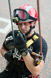 Fire Fighter Darren Monette of the South Yorkshire Fire Service Technical Rescue Unit demonstrates Abseiling Techniques at Aston Park fire station open day on Saturday.113933-03.13 August 2011  Image © Paul David Drabble