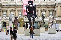 © Licensed to London News Pictures. 31/05/2019. LONDON, UK.  People view a major installation of six recent sculptures by celebrated artist Thomas Houseago is unveiled in the courtyard of the Royal Academy of Arts in Piccadilly.  The installation forms part of The Summer Exhibition which runs 10 June to 12 August 2019.  Photo credit: Stephen Chung/LNP