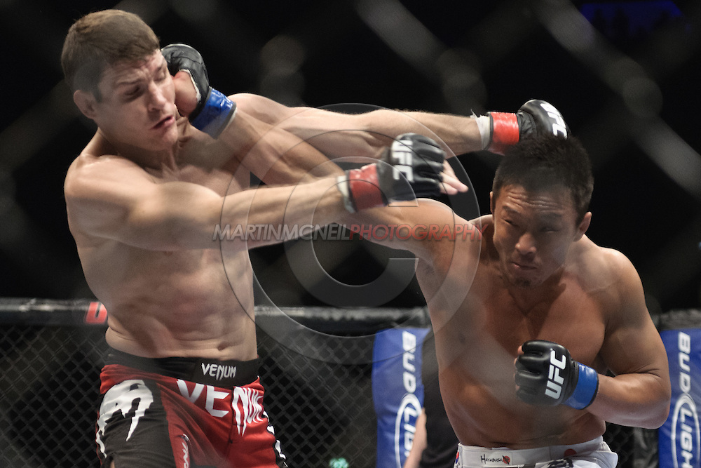 """LONDON, ENGLAND, OCTOBER 2010: Michael Bisping (left) is clipped by a punch from Yoshihiro Akiyama during """"UFC 120: Bisping vs. Akiyama"""" inside the O2 Arena in Greenwich, London"""