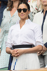 © Licensed to London News Pictures. 13/07/2019. London, UK., HRH The Duchess of Sussex watches the ladies singles finals on centre court tennis on Day 12 of the Wimbledon Tennis Championships 2019 held at the All England Lawn Tennis and Croquet Club. Photo credit: Ray Tang/LNP
