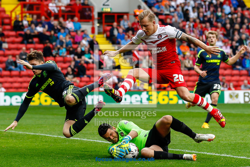 Stephen Henderson of Charlton Athletic (centre) collects the ball under pressure from Adam Reach of Middlesbrough (left) as Chris Solly of Charlton Athletic (right) closes down during the Sky Bet Championship match at The Valley, London<br /> Picture by David Horn/Focus Images Ltd +44 7545 970036<br /> 27/09/2014