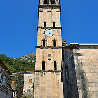St. Nicholas Church in Perast, Montenegro<br /> With a belfry reaching 179 feet, St. Nicholas Church is the most prominent landmark on Perast's shoreline. The five-story tower was built in 1691 and the Venetian clock was added in 1730.  The namesake for this unfinished church is Nikolaos of Myra, a bishop and Christian saint from the 4th century.  Dedicating a house of prayer to the patron saint for sailors and fishermen seems logical for a town dependent on the sea throughout its history.