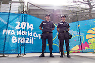 Two armed police officers stand guard outside the Maracana stadium. A significantly increased police presence is in evidence around the Maracana stadium before the 2014 FIFA World Cup match at Maracana Stadium, Rio de Janeiro, Brazil. This follows the storming of the Stadium Media Centre by Chilean fans earlier in the week. <br /> Picture by Andrew Tobin/Focus Images Ltd +44 7710 761829<br /> 22/06/2014