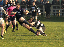 Ballinrobe&rsquo;s Dave Madden goes low to tackle Westport&rsquo;s Liam Scahill during the junior cup match.<br />Pic Conor McKeown