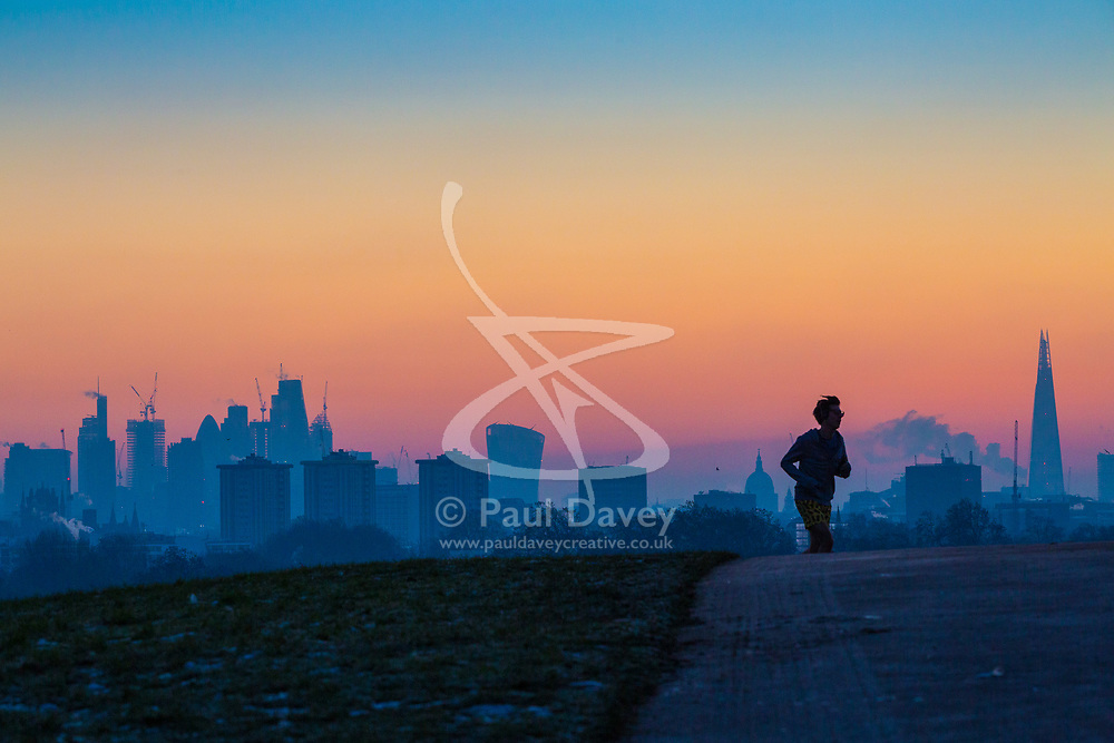 London, December 12 2017. A runner reaches the top of Primrose Hill mites before the sunrise on a clear very cold morning in London. © Paul Davey