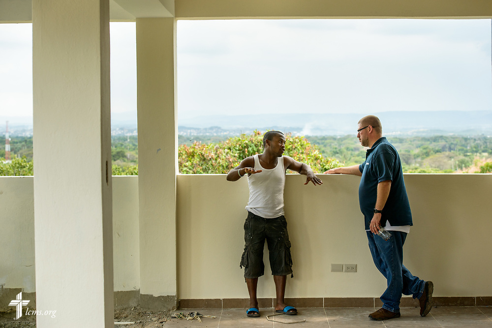 The Rev. Joel Fritsche talks with the foreman during a visit at the Concordia Reformer Lutheran Seminary and Mercy Center in Santiago, Dominican Republic, on Monday, March 20, 2017.  LCMS Communications/Erik M. Lunsford