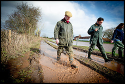 UKIP Leader Nigel Farage (left) looks out onto the flood near Burrowbridge, Somerset, United Kingdom. Sunday, 9th February 2014. Somerset has been flooded since the start of 2014, with people being forced to leave their homes. Picture by Andrew Parsons / i-Images