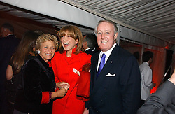 Left to right, DAME VIVIEN DUFFIELD and the RT.HON BRIAN MULRONEY former Prime Minister of Canada and his wife MILA MULRONEY at the annual Chelsea Flower Show dinner hosted by jewellers Cartier at the Chelsea Pysic Garden, London on 22nd May 2006.<br /><br />NON EXCLUSIVE - WORLD RIGHTS