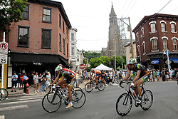 Pro-cyclist speed over Manayunk Mainstreet during the 27th TD Bank Philadelphia International Cycling Championship. (Bas Slabbers/for NewsWorks)..