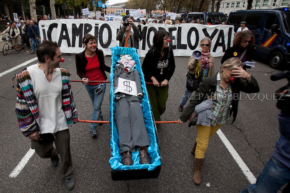 Spain's 'indignant' protesters march carrying a coffin with the pictures of Socialist Party (PSOE) leader Alfredo Perez Rubalcaba and Popular Party (PP) leader Mariano Rajoy on November 13, 2011in Madrid, Spain, to protest against spending cuts, high unemployment and political corruption, a week before a general election. Spain's so-called 'indignant' protest movement was born when thousands of people set up camp in Madrid's Puerta del Sol square ahead of May 22 municipal elections. (PABLO BLAZQUEZ)