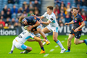 Jamie Ritchie (#6) of Edinburgh Rugby is tackled by Sam Johnson (#12) of Glasgow Warriors during the 1872 Cup second leg Guinness Pro14 2019_20 match between Edinburgh Rugby and Glasgow Warriors at BT Murrayfield Stadium, Edinburgh, Scotland on 28 December 2019.