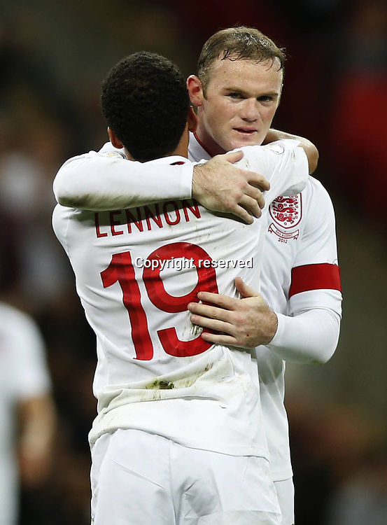 12.10.2012. Wembley Stadium, London, England.  Wayne Rooney  of England Celebrates scoring with His teammate Aaron Lennon during The FIFA 2014 World Cup Group H Qualifying Match between England and San Marino AT Wembley  Stadium. England won the game by a score of 5-0.