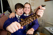 "EXCLUSIVE<br /> <br /> Best friends Hannah Binyon and Storm Wilson have a lot to be thankful not least their solid friendship born out of devastating illness.<br /> <br /> The ten-year-olds have battled back from frightening sickness which threatened both of their young lives. As a result, the classmates have formed such a close bond they help each other through day to day life. And to show the world their fighting spirit, young Storm has had 2ft 6ins of her long locks chopped off – her first ever hair cut - to support the charity which helped her best friend.<br /> <br /> Hannah's mum Gemma, from Rayleigh, Essex, said: ""What Storm has done for their friendship is a huge deal. We're totally overwhelmed that she would do that. Storm just kept saying 'wow' when she heard what her friend was doing for her. What a lovely thing to do.<br /> <br /> ""Hannah wore a wig occasionally when she lost her hair through chemo and Storm knows that. What an amazing little girl.""<br /> <br /> Back in 2010, a five-year-old Hannah was diagnosed with stage four neuroblastoma, a rare childhood cancer found in the nerve cells. By the time her mystery illness was diagnosed, she had to be placed into a coma to give medics at Great Ormond Street Hospital time to act. Her parents were told there was a 10% chance of her beating it.<br /> <br /> Gemma said: ""She had been poorly for six months, crying every night saying her legs hurt. She lost lots of weight and, to me, she looked like she was dying, but the doctors couldn't work out what was wrong. She stopped eating, stopped playing and stopped being happy. That Christmas, she didn't even want to open her presents. When she collapsed at school, we rushed her to A&E and insisted on answers. Within an hour of being taken to GOSH, she had been diagnosed.<br /> <br /> ""By then, she was almost paralysed as she was riddled with cancer.""<br /> <br /> After a year of treatment, Hannah has been left with a dormant tumour on her spine and nerve damage to her feet giving her mobility problems.<br /> <br /> Her mum said: ""I was worrie"