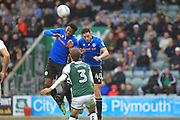 Kgosi Nthle and Ian Henderson compete for a header during the EFL Sky Bet League 1 match between Plymouth Argyle and Rochdale at Home Park, Plymouth, England on 28 October 2017. Photo by Daniel Youngs.