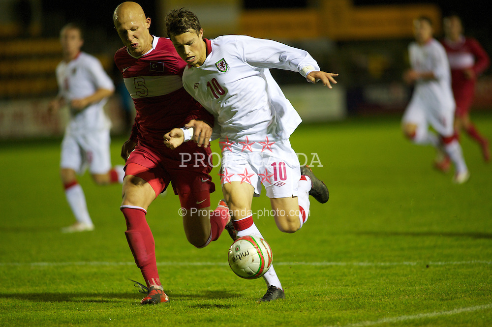 CARMARTHEN, WALES - Wednesday, October 20, 2010: Wales' Billy Bodin in action against Turkey's Sezer Ozmen during the UEFA Under-19 Championship Qualifying Group 1 match at Richmond Park. (Photo by Gareth Davies/Propaganda)