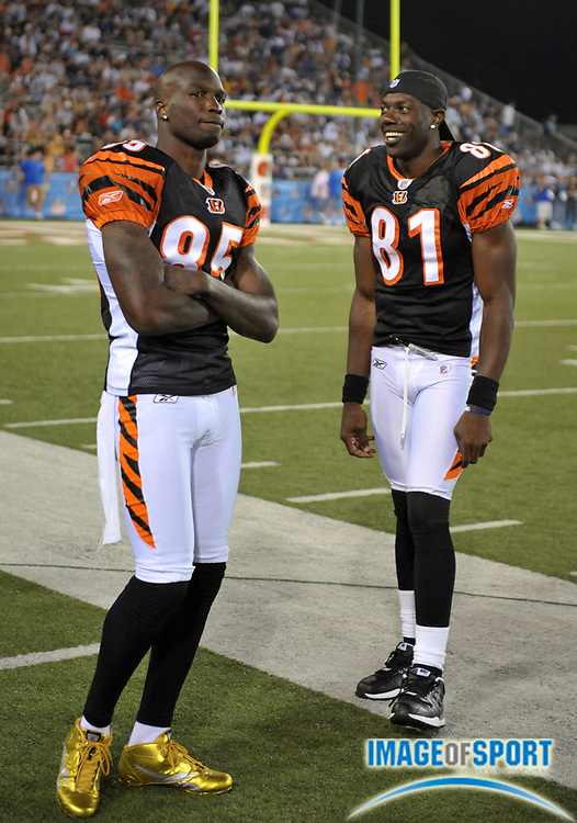 Aug 8, 2010; Canton, OH, USA; Cincinnati Bengals receivers Chad Ochocinco (85), left, and Terrell Owens (81) watch on the sidelines during the fourth quarter of a preseason game against the Dallas Cowboys at Fawcett Stadium. Photo by Image of Sport