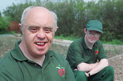 Men with Downs Syndrome at work on a community allotment project,