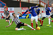 Liam McAlinden (19) of Exeter City is tackled by Danny Collins (6) of Grimsby Town during the EFL Sky Bet League 2 match between Exeter City and Grimsby Town FC at St James' Park, Exeter, England on 11 November 2017. Photo by Graham Hunt.