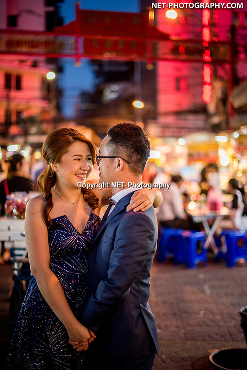 Engagement session (pre-wedding, prenuptial) at China Town (Yaowarat) in Bangkok, Thailand.<br /> <br /> <br /> Photo by NET-Photography<br /> Thailand Professional Documentary Wedding Photographer<br /> <br /> <br /> Read our blog about this Bangkok prenuptial at https://thailand-wedding-photographer.com/bangkok-engagement-session-at-wat-arun-china-town/<br /> <br /> <br /> https://thailand-wedding-photographer.com<br /> info@net-photography.com<br />   <br /> LIKE US ON FACEBOOK !<br /> https://www.facebook.com/thailandweddingphotographer/<br /> <br /> <br /> FOLLOW US ON INSTAGRAM !<br /> https://www.instagram.com/net__photography/