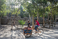 Exploring the ancient Mayan ruins at the Coba archeological site in Coba, Mexico. The fastest way to explore the sprawling site is via pedicab. Bicycles are also available for rent at the entrance, or visitors may explore the site on foot.