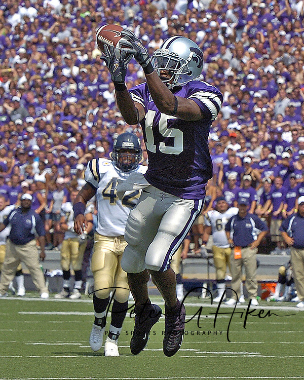 Kansas State wide receiver Davin Dennis (15) goes up to make a catch against Florida International's Keyonvis Bouie (7) in the third quarter.  Kansas State defeated Florida International 35-21 at KSU Statdium in Manhattan, Kansas on September 3, 2005.