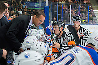 PENTICTON, CANADA - SEPTEMBER 17: The referee speaks to the Edmonton Oilers head coach at the bench against the Calgary Flames on September 17, 2016 at the South Okanagan Event Centre in Penticton, British Columbia, Canada.  (Photo by Marissa Baecker/Shoot the Breeze)  *** Local Caption ***