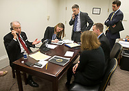 Sen. Chuck Grassley (from left) talks on the phone during one of two press conference calls he completed over the lunch break as Beth Pellett Levine, Communications Director for Chairman Grassley on the Senate Committee on the Judiciary, Taylor Foy, Press Secretary for Chairman Grassley on the Senate Committee on the Judiciary, Jill Gerber, Communications Manager and Senior Writer, George Hartmann, Assistant Press Secretary, and Michael Zona, Deputy Press Secretary, work around him during the third day of hearings before the Senate Judiciary Committee for Neil Gorsuch to become an Associate Justice of the US Supreme Court in the Hart Senate Office Building in Washington, D.C. on Wednesday, Mar. 22, 2017.