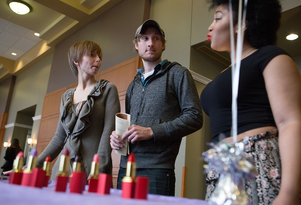 Julia Miller, left, and Dan Lazarz examine all-natural lipstick sold by vendor Lana Lip Care at the Sixth Annual International Women's Day Festival, held in Baker Center Ballroom on March 16, 2014. Ashley Osborne, far right, a cohost of the event, models some of the lipstick. The event, sponsored in part by the Ohio University Women's Center, educated audiences about women's progress, celebrated women's achievements, and included numerous performances by female members of the Athens and Ohio University community. International Women's Day itself fell on March 8, 2014. Photo by Lauren Pond