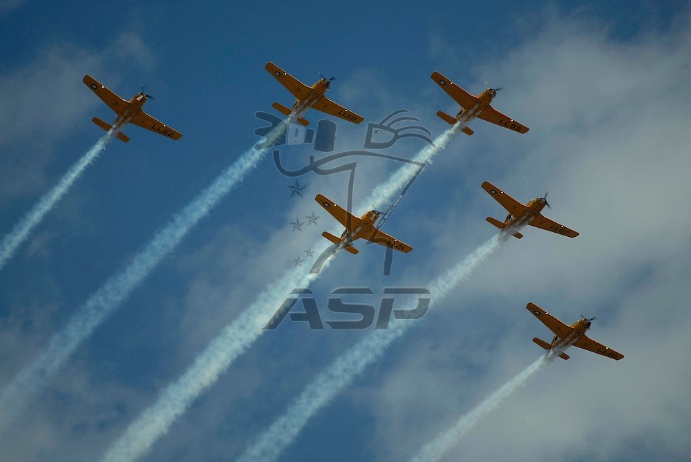 A group of World War II military aircraft performa flyby  before the start of the GNC Live Well 250 NASCAR Busch Grand National race at the Milwaukee Mile in West Allis, Wisconsin.