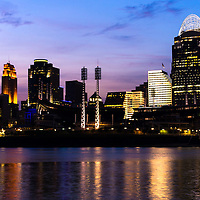 Photo of Cincinnati at night with downtown city skyline office buildings including Great American Ballpark, Great American Insurance Group Tower, PNC Tower building, Omnicare building, US Bank building, Carew Tower building, Scripps Center building, and Fifth Third building. Photo was taken in July 2012.