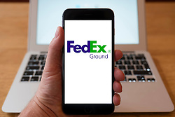 Using iPhone smartphone to display logo of FedEx Ground parcel delivery company