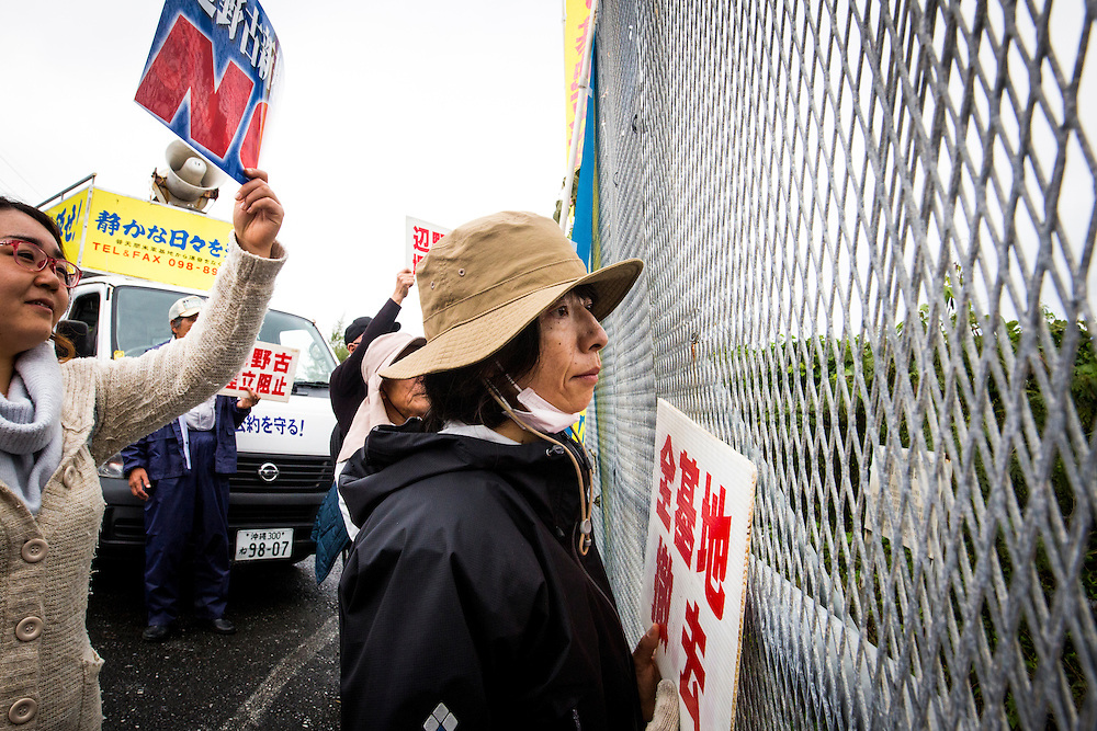 OKINAWA, JAPAN - JANUARY 19 : A woman look at the construction during a protest against the relocation of the new U.S Marine Airbase construction in Oura Bay, Camp Schwab, Henoko, Nago, Okinawa, Japan on Janaury 19, 2017. The scheduled reclamation area for new the construction totals 160 hectares and will include 2 runways. Construction of the new base will require 21 million cubic meters of soil, enough to fill the Okinawa Prefectural Office 70 times, 17 million tons of which will be hauled in from Kyushu and Shikoku. (Photo by Richard Atrero de Guzman/NURPhoto)