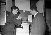 Young Scientists Exhibition.1969..01/01/1969.1st January 1969..The Aer Lingus Young Scientist Exhibition 1969 at the RDS..Luke O'Connor Drury showing his winning exhibit 'the construction and use of a spectrophometer to investigate complexion formation in a transition metal' to Brian Lenihan, T.D....