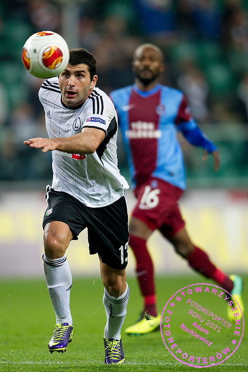 Legia's Vladimer Dvalishvili controls the ball during the UEFA Europa League Group J football match between Legia Warsaw and Trabzonspor AS at Pepsi Arena Stadium in Warsaw on November 07, 2013.<br /> <br /> Poland, Warsaw, November 07, 2013<br /> <br /> Picture also available in RAW (NEF) or TIFF format on special request.<br /> <br /> For editorial use only. Any commercial or promotional use requires permission.<br /> <br /> Mandatory credit:<br /> Photo by &copy; Adam Nurkiewicz / Mediasport
