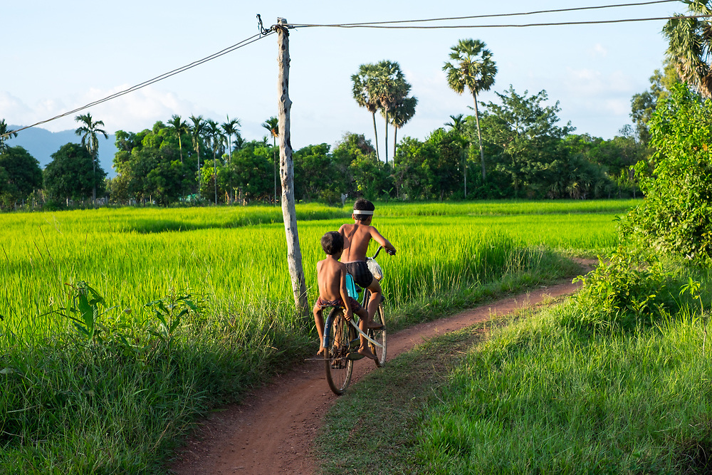 Cycling in the Ricefieds around Kampot, Cambodia. Photo by Lorenz Berna