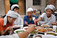 Mourning for the first anniversary of the passing of the family elder in a christian family in Shaanxi province in China. September 2005.