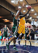 November 27, 2011; Moraga, CA, USA; San Francisco State Gators forward James Albright (44) drives to the basket against Saint Mary's Gaels center Kyle Rowley (left) during the first half of the Shamrock Office Solutions Classic at McKeon Pavilion.