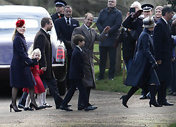 EXCLUSIVE ALL ROUNDER The royal family attend St Mary Magdalene Church on the Sandringham estate. Meghan Markle joined Prince Harry the Duke of Cambridge and Duchess of Cambridge for their walk to the church. Meghan could not resist joking and waving at a member of the crowd<br />