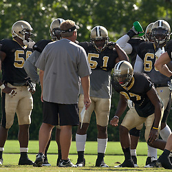 10 August 2009: New Orleans Saints cornerback Malcolm Jenkins (27) performs the up downs conditioning drill during New Orleans Saints training camp at the team's practice facility in Metairie, Louisiana.