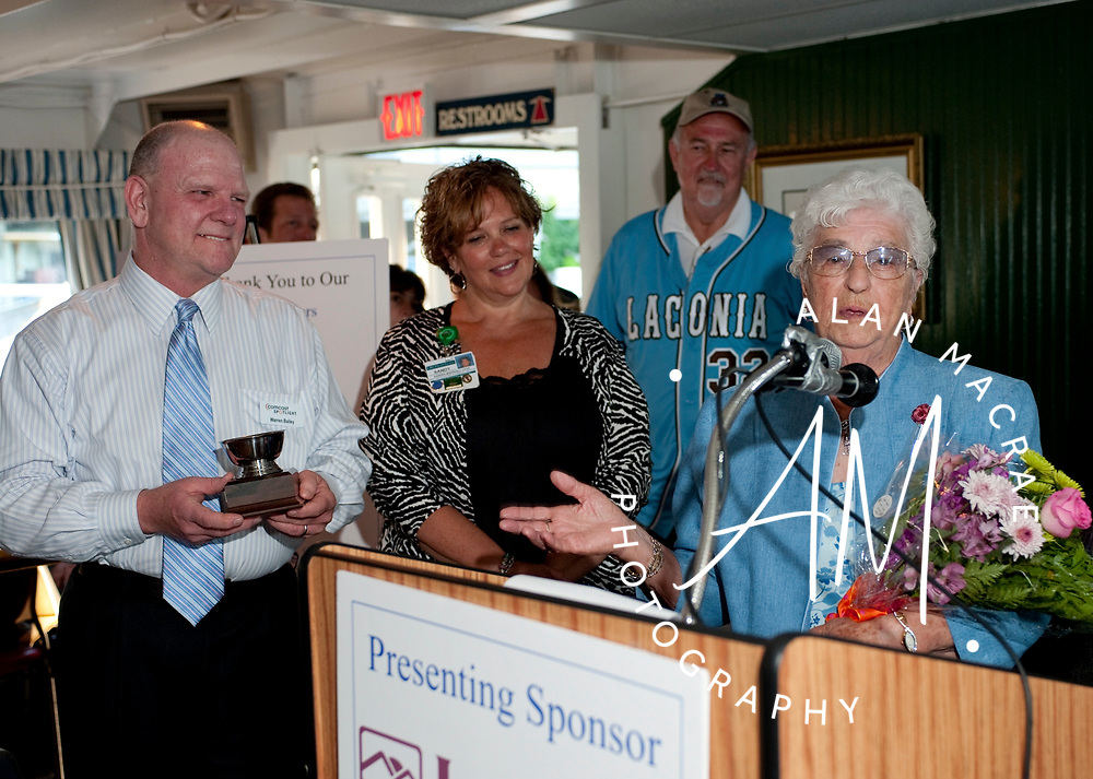 Gemma Hamel offers some emotional comments after being named this year's recipient of the James Irwin Award at last night LRCC event aboard the MS Mount Washington.  With Hamel are Warren Bailey, Sandy Marshall, and Lou Guevin.  (Alan MacRae/for the Citizen)