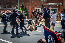"Full-on fighting occurred in front of the Charlottesville Police Station.  All the officers stood by and watched, never arresting or stopping the violence throughout the entire day. On Saturday, August 12, 2017, a veritable who's who of white supremacist groups clashed with hundreds of counter-protesters during the ""Unite The Right"" rally in Charlottesville, Va. Dozens were injured in skirmishes and many others after a white nationalist plowed his sports car into a throng of protesters.  One counter-protester died after being struck by the vehicle. The driver of the car was caught fleeing the scene and the Governor of Virginia issued a state of emergency. (Photos by Michael Nigro)"