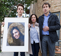 © Licensed to London News Pictures. 28/09/2018. London, UK.  Nadim Ednan-Laperouse (C), his son Alex (L) and wife Tanya (R) leave West London Coroner's Court with a photograph of Natasha Ednan-Laperouse following the inquest into the death of Natasha Ednan-Laperouse. Natasha Ednan-Laperouse, aged 15, died on a British Airways flight to from London to Niece, when she fell ill after eating a Pret a Manger sandwich believed to contain sesame.  Photo credit: Vickie Flores/LNP
