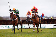 Plumpton, UK, 16th January 2017<br /> Paddy Brennan uses his whip on Easter in Paris as he chases race winner Paul Moloney and Yourholidayisover (R) during the 'My Dashboard' On The Timeform App Handicap Chase at Plumpton Racecourse.<br /> &copy; Telephoto Images / Alamy Live News
