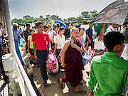 30 OCTOBER 2015 - YANGON, MYANMAR:  Passengers get off the Dala ferry in Dala. The ferry to Dala runs continuously through the day between Yangon and Dala. Yangon, Myanmar (Rangoon, Burma). Yangon, with a population of over five million, continues to be the country's largest city and the most important commercial center.          PHOTO BY JACK KURTZ