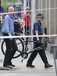 © Licensed to London News Pictures. 15/08/2018. London, UK. Police carry a broken bicycle from the scene of an accident at Holborn where a cyclist has died after being hit by a lorry - believed to be former doctor to the Queen Peter Fisher. Photo credit: Rob Pinney/LNP