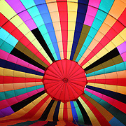 Inside the brightly colored balloon of Rubens Rosdon Kalousdian, Brazil, as his crew prepares the balloon for launch during The World Hot Air Ballooning Championships. Battle Creek, Michigan, USA. 19th August 2012. Photo Tim Clayton